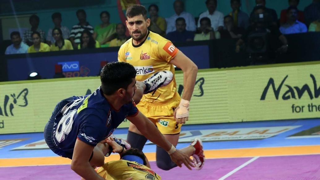 Six Super Tackles by their defence help Telugu Titans clinch thriller
